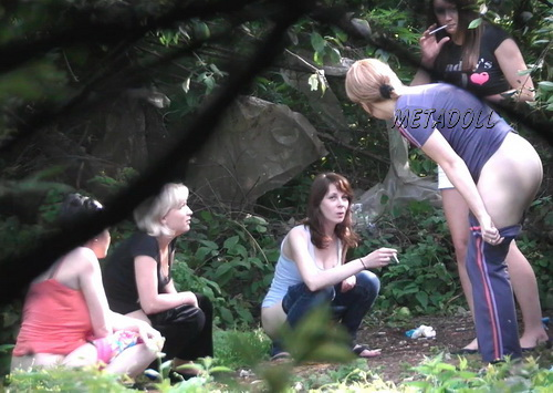 Hiding Place WC 21 (Girls takes a piss squatting near the bushes in this voyeur video)