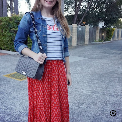 awayfromblue instagram denim jacket red boho print maxi skirt Rebecca Minkoff love bag guitar strap