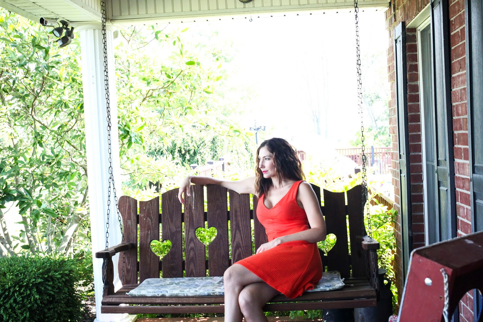 Amy West relaxing on porch swing in Kentucky