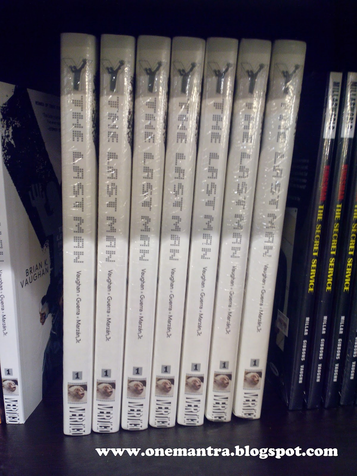 Tons of copies of the Deluxe Edition of Vol 1 of Y: The Last Man in  Hardcover at the FullyBooked booth