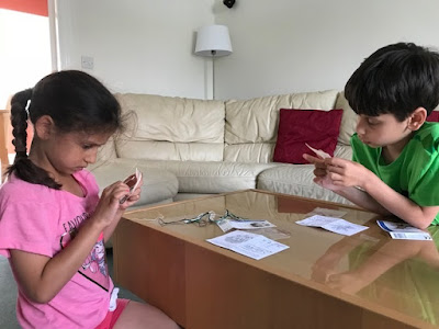 Children cross stitching together
