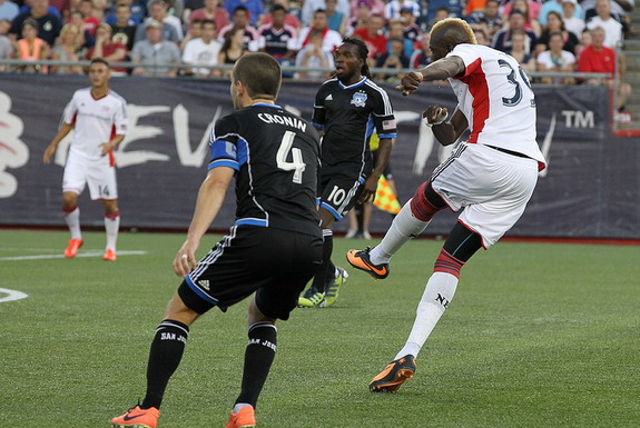 New England Revolution player Saër Sène shoots to score the opener against San Jose Earthquakes