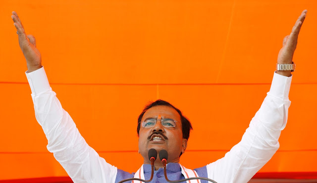 Image Attribute: Keshav Prasad Maurya, the Uttar Pradesh state's president for the ruling Bharatiya Janata Party (BJP), gestures as he addresses an election campaign rally in Bah, in the central state of Uttar Pradesh, India, February 2, 2017. REUTERS/Adnan Abidi