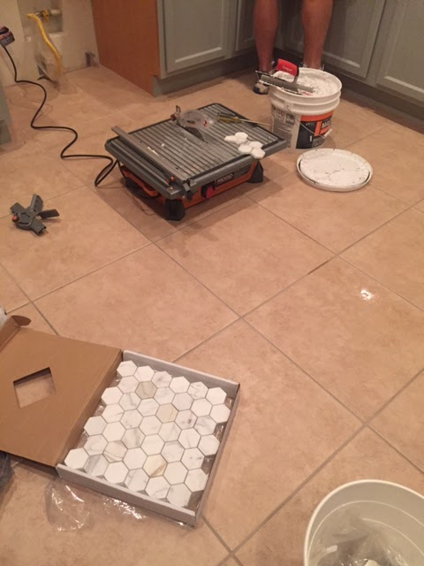 Progress pf Calacatta Gold marble mosaic wall at Hello Lovely Arizona Fixer Upper Kitchen