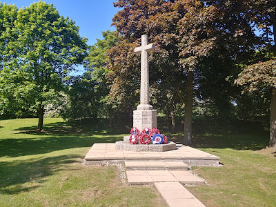 Photograph of the south side of the war memorial with Tollgate Road beyond. Image by the North Mymms History Project released under Creative Commons