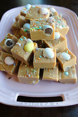 stack of mini egg peanut butter fudge squares on pink platter
