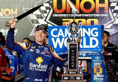 Kyle Busch Celebrates In Victory Lane with the Winner's Trophy - #NASCAR