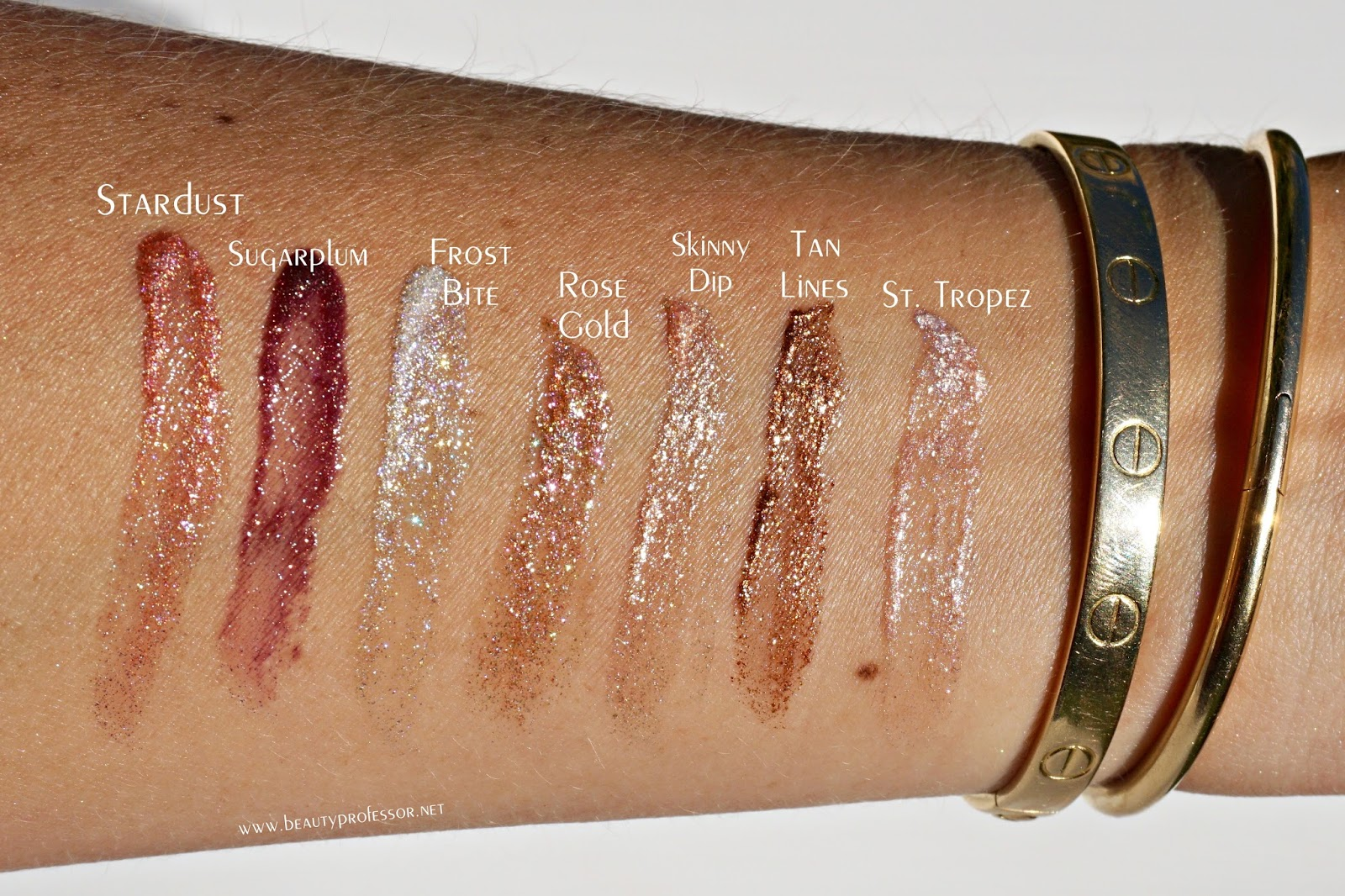Swatches of the Jouer Best of Lip Toppers Mini Gift Set in direct sunlight. 2135e01bf