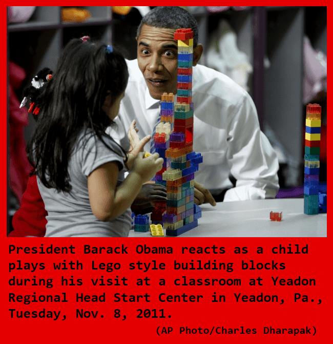President Barack Obama watches a child play with legos