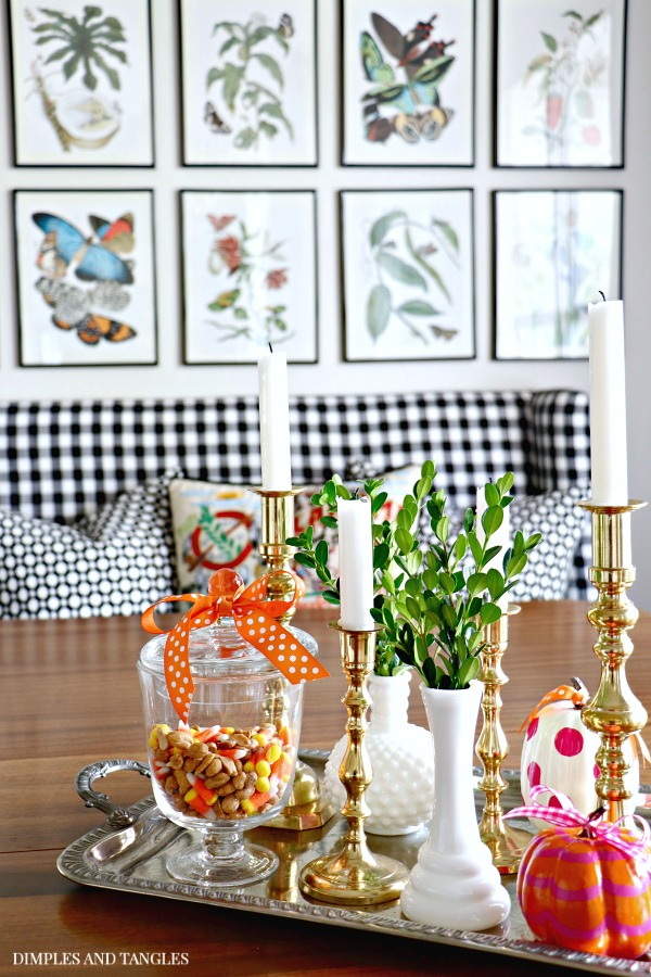 botanical gallery wall, silver tray, brass candlesticks, centerpiece, painted pumpkins, gingham settee, black and white, betwixt pillow, cat studio pillow