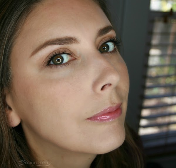 wearing lancome prismatic plump gloss in passion glow