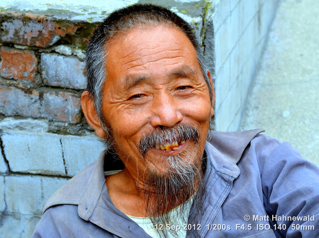 street portrait, headshot, China, Xi'an, Chinese man, bad teeth