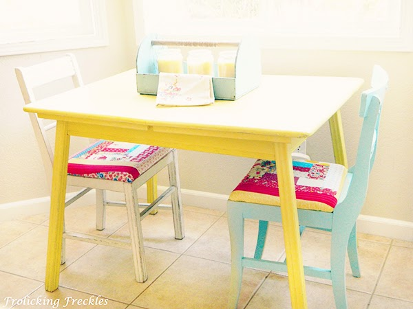 painted yellow table with painted chairs