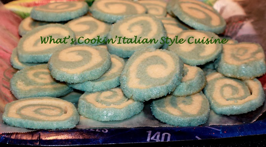These are a basic slice and bake homemade cookie recipe rolled into homemade colored blue sugar before baking with two colors of dough for a boys baby shower.
