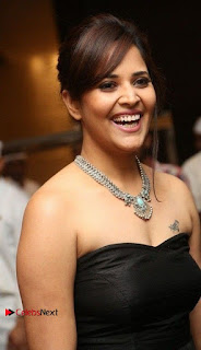 Telugu Anchor Actress Anasuya Bharadwa Stills in Strap Less Black Long Dress at Winner Pre Release Function  0008.jpg