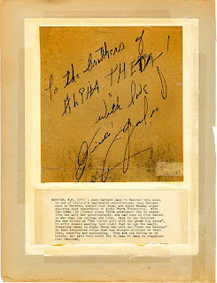 A note and signature from Judy Garland, with a typed explanation taped beneath it.