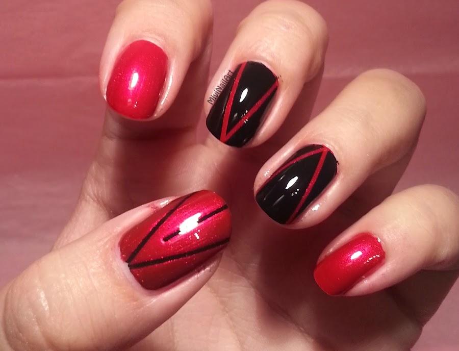 http://mivinailart.blogspot.com.es/2014/01/manicura-negro-y-rojo.html