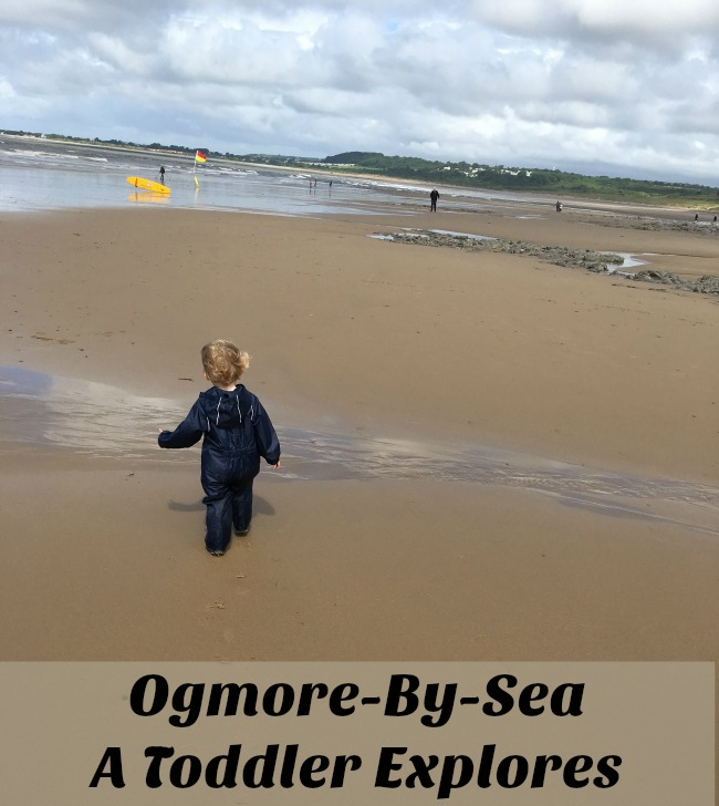 Ogmore-by-sea-a-toddler-explores-text-on-picture-of-toddler-on-beach