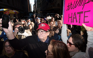 Film Maker Michael Moore Is Blocked By Secret Service On The Fourth Floor Of Trump Tower from confronting President-elect - before Joining Thousands Of Protesters In The Streets Of New York