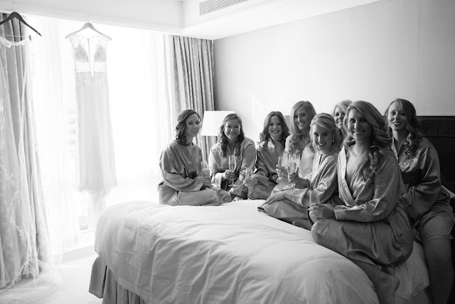 Bridesmaids on the bed before Jenna's Willow Ridge Country Club Wedding | Karen Hill Photography