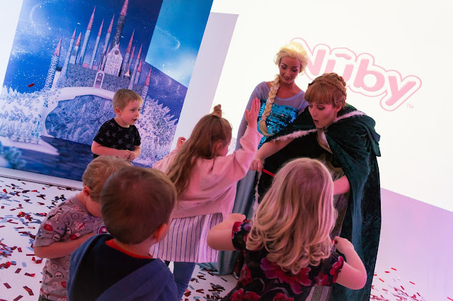 children playing with ana and elsa from frozen at nuby big reveal event
