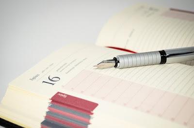 Calendar book and pencil