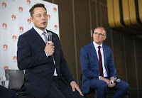 South Australian Premier Jay Weatherill (R) listens to Tesla Chief Executive Officer Elon Musk speak during an official ceremony in Adelaide, Australia, July 7, 2017 to announce that Tesla will install the world's largest grid-scale battery in the South Australian state. (Credit: AAP/Ben Macmahon/via Reuters) Click to Enlarge.