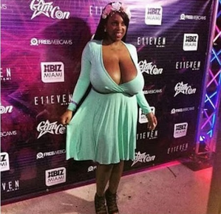 Lady With Massive Boobs Causes A Stir In Pubic After Appearing In A Very Revealing Dress Photo