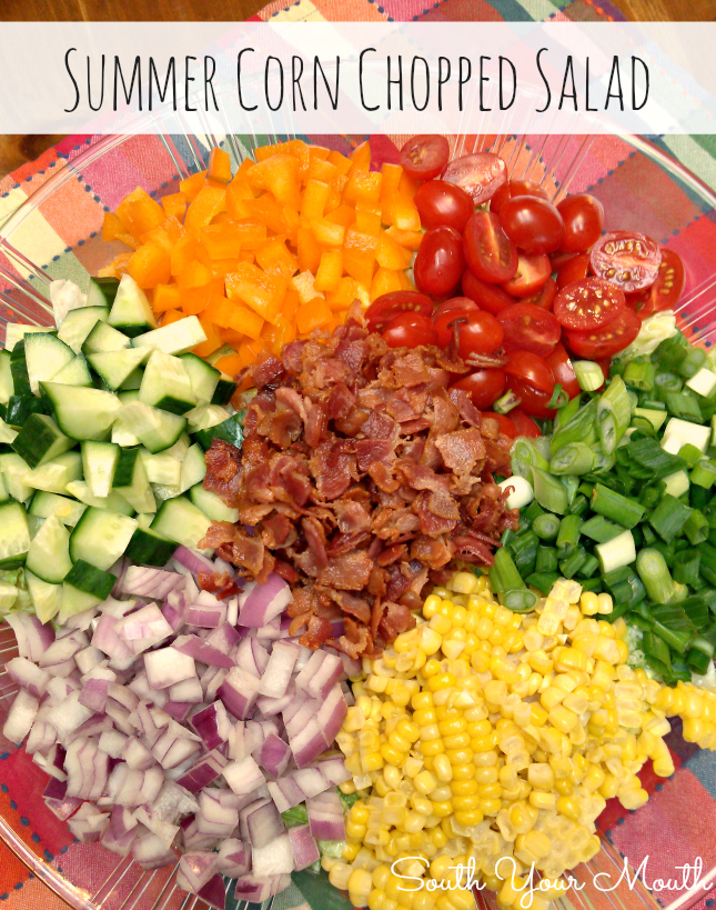 Easy chopped salad with fresh corn, bacon, crisp veggies and dried cranberries.