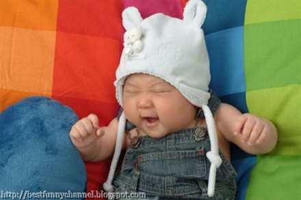 Funny baby in a cap.