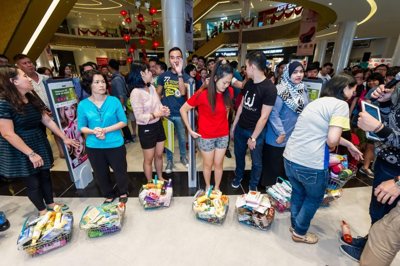 Watsons VIP Members with their shopping basket filled with Watsons Brand products after the shopping spree.
