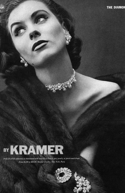 Black and White photograph of model wearing Costume Jewelry by Kramer named Polonaise in 1952
