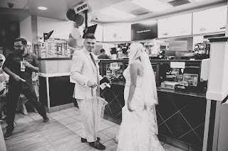 bride and groom getting mcdonalds before reception