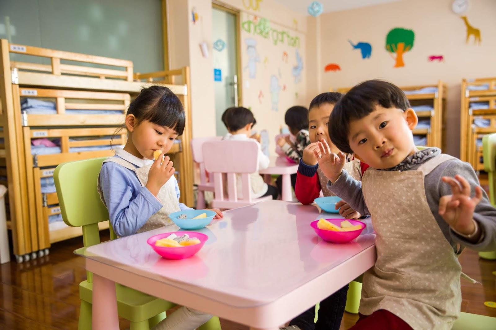 NAMC Montessori cosmic education and world food day. Children having snack.