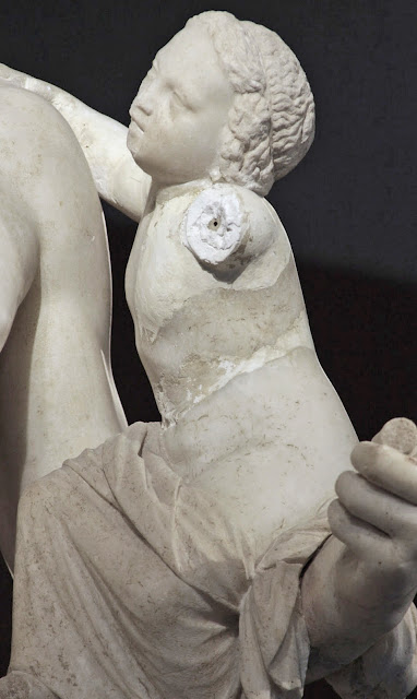 The Bitch is back: Hermes of Praxiteles