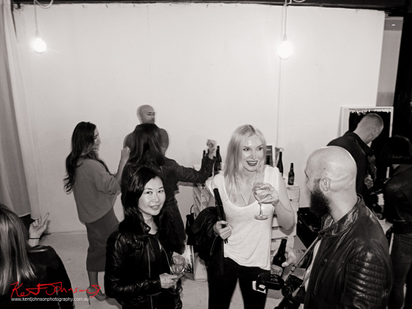 Bloggers mingling at the Neuw FORM Designer's Denim launch. Photography by Kent Johnson.