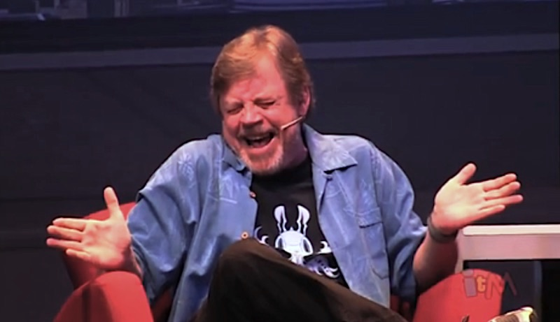 Mark Hammill laughing maniacally as he voices The Joker