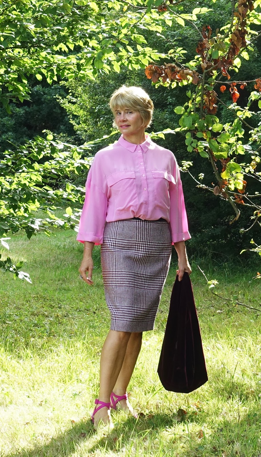With the shorter days but the last rays of summer sunshine, a Prince of Wales check skirt is a nod to Autumn and worn with sandals and a crisp silk blouse, smart and transitional for work