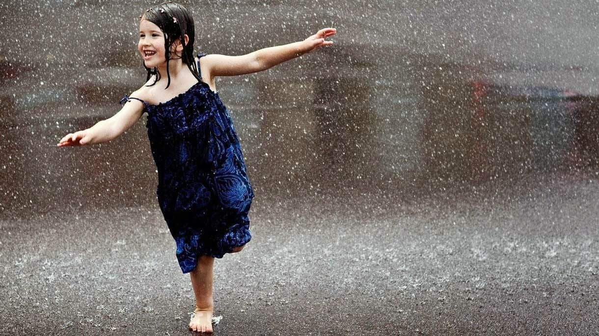 Cute Girl Dancing in Rain