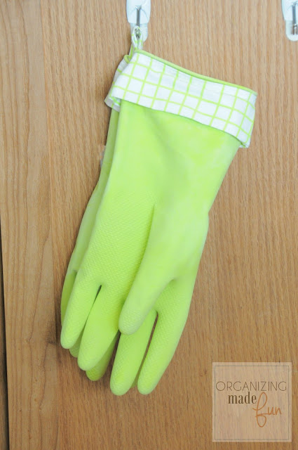 Loop on rubber gloves to hang dry :: OrganizingMadeFun.com