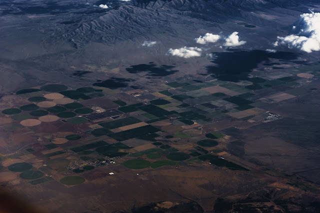 An aerial view of farms with fields made in circular fashion ... not crop circles, but has a similar look.