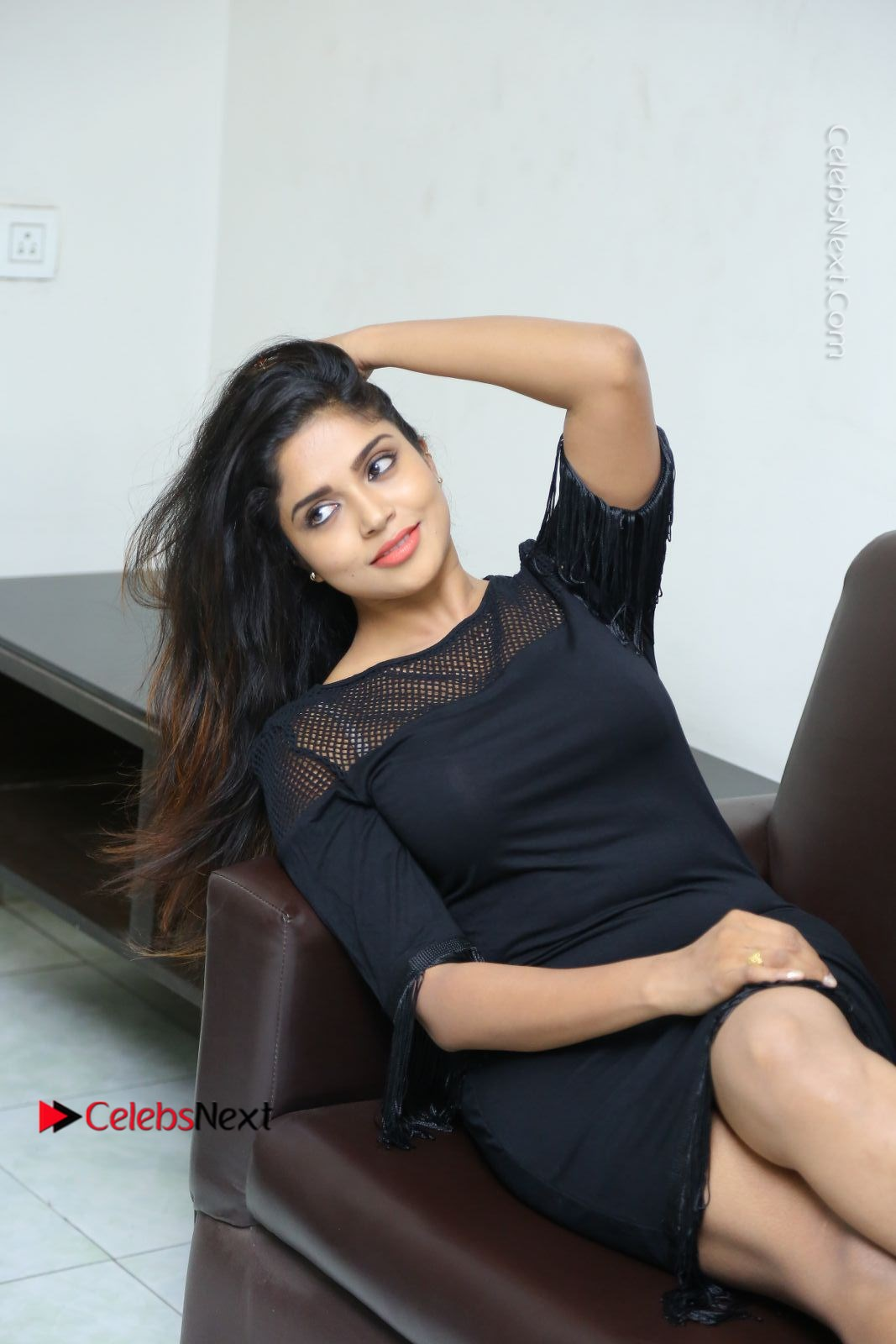 Karunya Chowdary Latest Stills in Black Short Dress at Edo Prema Lokam Audio Launch