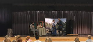 Tecumseh Performance on stage at Zane Trace School