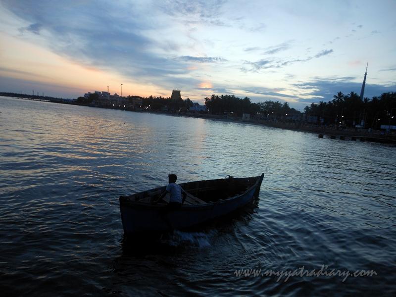 A lone boat sails away in Rameswaram, Tamil Nadu