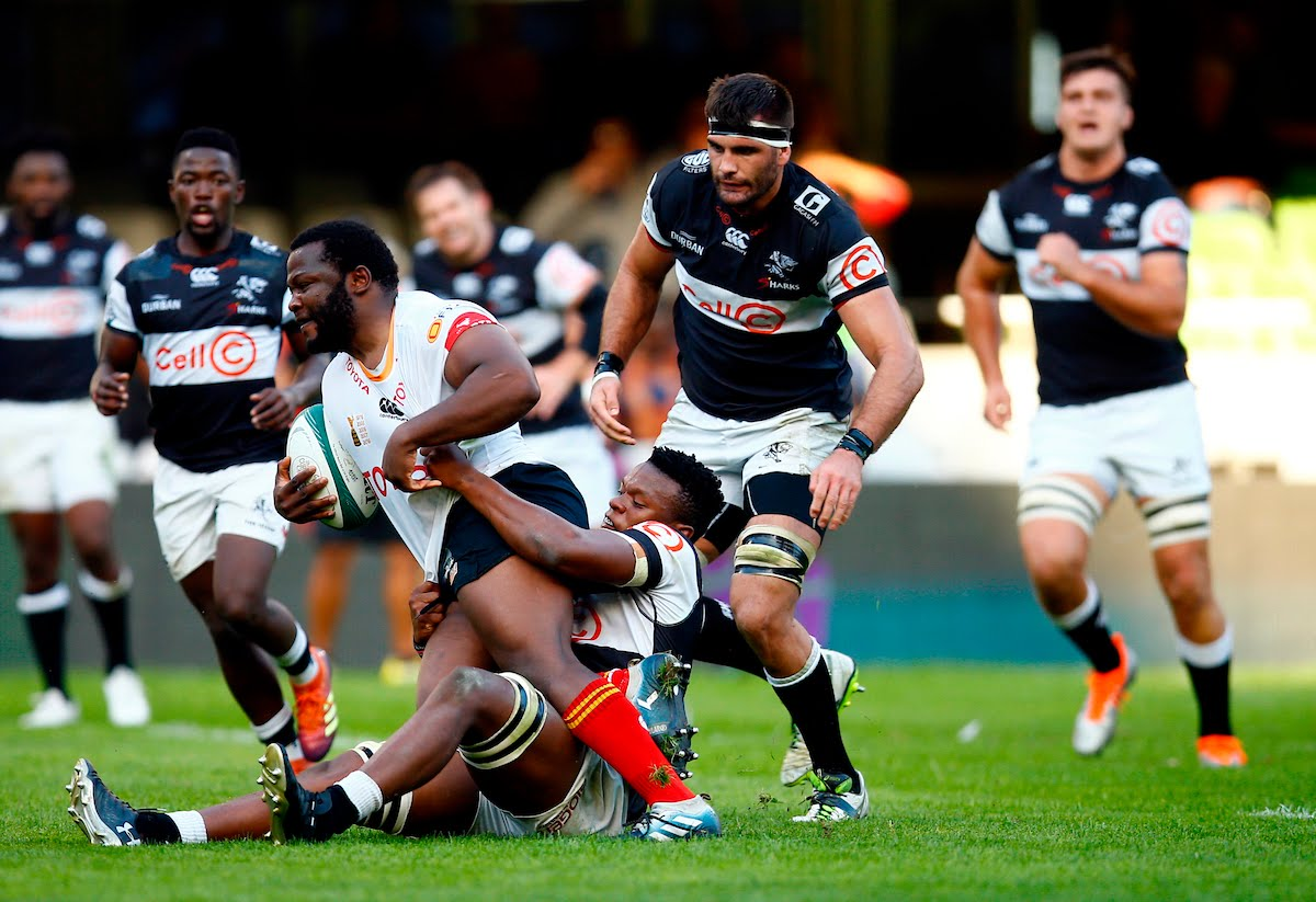 Phendulani Buthelezi of the Cell C Sharks looks to tackle Ox Nche of the Free State Cheetahs during the Currie Cup match between the Cell C Sharks and the Free State Cheetahs at Jonsson Kings Park Stadium in Durban
