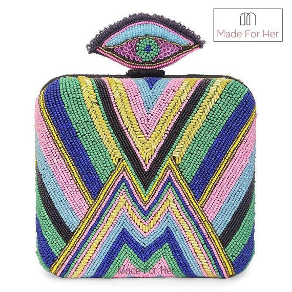 Striped beadwork clutch bag in pastel colours with evil eye clasp by Made For Her