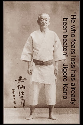 "Image of Professor Kano, the founder of Judo, in his Judogi and quote: ""He who fears loss has already been beaten"""