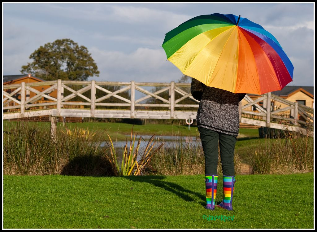 13. Girl with rainbow wellies and a rainbow multi coloured umbrella