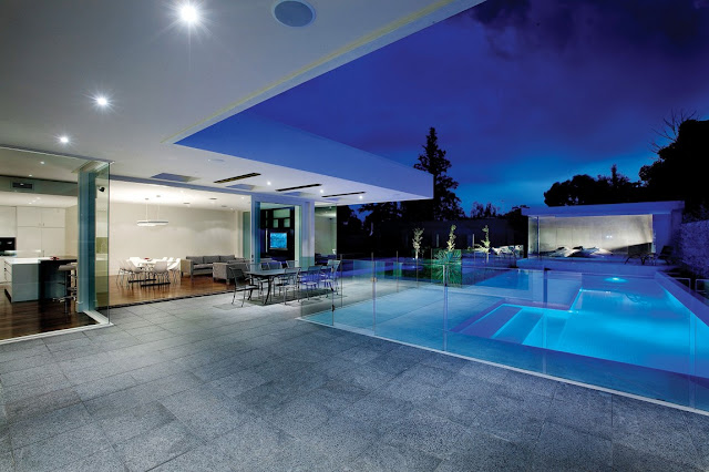Large terrace of modern home at night