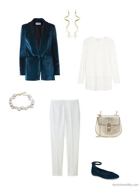 a holiday outfit in winter white with teal accents